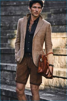 Andres Velencoso Segura wears chic shorts with a linen blazer from Massimo Dutti.