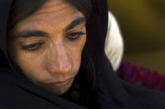 A close-up of a woman former refugee at the UN High Commission for Refugees (UNHCR)'s returnee camp in Sari Pul, Afghanistan.  UN Photo/Eric Kanalstein.
