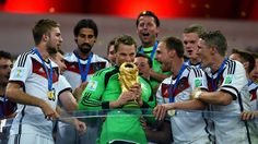 RIO DE JANEIRO, BRAZIL - JULY 13: Manuel Neuer of Germany lifts the World Cup to celebrate with his teammates during the award ceremony after the 2014 FIFA World Cup Brazil Final match between Germany and Argentina at Maracana on July 13, 2014 in Rio de Janeiro, Brazil. (Photo by Shaun Botterill - FIFA/FIFA via Getty Images)