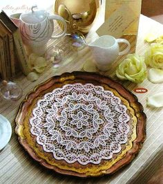 Amazing doily....play with circle and extending sides to shawl...?     Close-up here:  http://img0.liveinternet.ru/images/attach/c/5/88/181/88181824_large_4.jpg    Chart here:  http://img1.liveinternet.ru/images/attach/c/5/88/181/88181825_large_5.jpg    Simple....which is good....=)