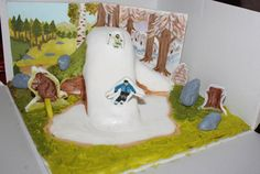 """A cake to celebrate the engagement of a gruffalo fan and a skier. Their """"ski top house"""""""