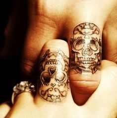 sugar skull finger tattoo.