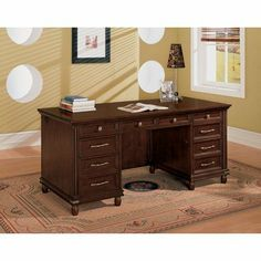 Keystone Executive Desk in Tawny Brown by Wynwood Furniture. $1000.00. 1210-34  Features: -Executive desk.-Features drop front center keyboard drawers with pencil tray.-Utility box with removable dividers.-File drawer in left pedestal.-Cable accessible.-Dust frequently with a clean dry, lint-free cloth. Color/Finish: -Tawny brown finish. Collection: -Keystone collection.