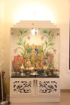 A small Pooja unit with semi transparent doors. Try this idea for a room with relatively small space.