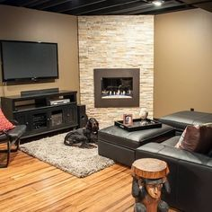 Basement remodel - PSch LOVE stone around gas fireplace! Would prefer gray/white mix veneer stones (small); different style gas f/p. More modern! NOT MY FAVORITE! Corner Gas Fireplace, Basement Fireplace, Fireplace Cover, Fireplace Remodel, Fireplace Wall, Living Room With Fireplace, Fireplace Design, Fireplace Ideas, Fireplace Makeovers
