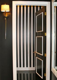 black and white striped walls and door