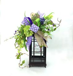 Spring lantern swag with wild flowers in the colors of lavender and lime green by www.southerncharmwreaths.com