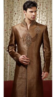 Golden Brown Brocade Wedding Sherwani is beautified with moti, sequins, beads, resham thread embroidered neck yoke, front panel style and embrodiered buttas.