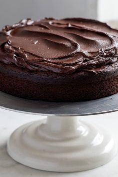"NYT Cooking: The recipe for this cake, adapted from ""Sweet"" by Yotam Ottolenghi and Helen Goh, first appeared in an article written about Ms. Goh when she ran her cafe, the Mortar & Pestle, in Melbourne, Australia. Rather intimidatingly for her, the headline for the article was ""World's Best Chocolate Cake."" It could actually be called lots of things: ""world's easiest cake,"" possibly,%..."