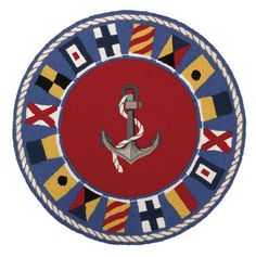 """Anchor an empty floor space at your beach home with this 36""""  Round Signal Flag Nautical Rug."""