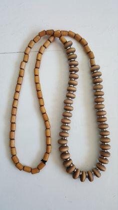 """Finnish Aarikka necklace from the This model is called """"Bolero"""". Material is lacquered wooden beads and metal rings threaded into a rubber band. Wooden beads color is """"sand"""" or very light beige. Wooden Crosses, Rubber Bands, Light Beige, Wooden Beads, Beaded Necklace, Etsy, Vintage, Color, Jewelry"""