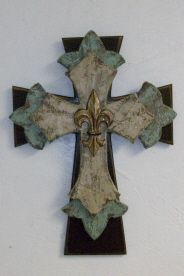 Love the brown/seablue/tan cross...but for $80???  Not....can make so much cheaper.  A Faux can be achieved with poster board, medallions, Corrugated plati-board would look phenomenal and the ever faithful foam board and your fav paints!!!!