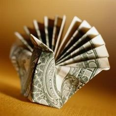How to Fold a Paper Owl With a Dollar Bill thumbnail