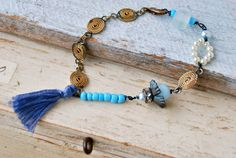 Shelby.bohemian,beaded,tassel,charm bracelet. tiedupmemories
