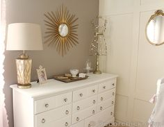 Gorgeous gold lamp is a HomeGoods find! Love this white dresser, this could be used in a nursery or big kid room.