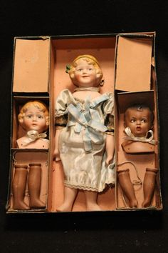 Interchangeable Bisque doll in original box, Ca 1900 black and white dolls.