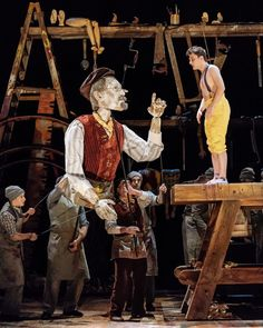 """In the National Theater production of """"Pinocchio,"""" Geppetto, left, is played by an oversized puppet and the title character by the actor Joe Idris-Roberts. Toy Theatre, Drama Theater, Theatre Stage, Puppetry Theatre, Living Puppets, Le Zoo, Marionette Puppet, Puppet Making, Puppet Show"""