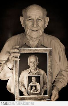 Great-grandfather holding a picture of his son holding a picture of his son holding a picture of his son.
