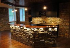 Love stone acccents around a bar. so easy DIY with our faux stone panels. add so much class and elegance to basement bar remodel.