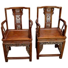 Two 19th Century Heavily Carved Chinese Hardwood Armchairs | From a unique collection of antique and modern furniture at https://www.1stdibs.com/furniture/asian-art-furniture/furniture/