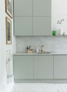 mint green kitchen cabinets + gold fixture + marble counter / backsplash