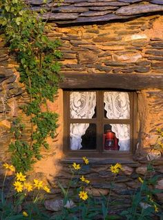 Lantern in a stone cottage window