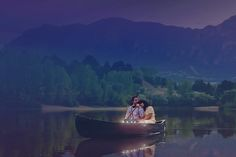 Couple in a canoe with candles at sunset - Jawnie Holsker Photography - A Colorado Courtship Blog