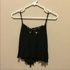 Black crop top Perfect condition. Has a flower design on the back Tops Tank Tops