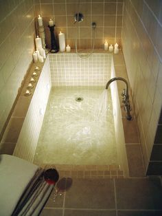 Sunken bath. Love the idea of steps.