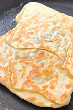 Malaysian flatbread with egg, onion and meat filling! This is a simple and easy version of murtabak. Dhal or curry are great choices to go with it. Ham Recipes, Indian Food Recipes, Asian Recipes, Ethnic Recipes, Bread Recipes, Roti Canai Recipe, Burfi Recipe, Ramadan Recipes, Ramadan Food