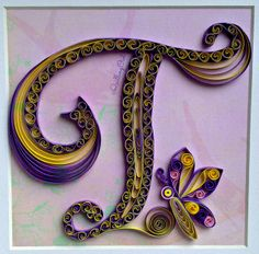 quilled letter T , created using 3mm strips of paper :)