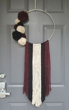 A Front Door Yarn Hanger for Under $5 ·   Want something for your front door that is not a wreath? Check out this affordable yarn door hanging. It is easy to make and definitely affordable.