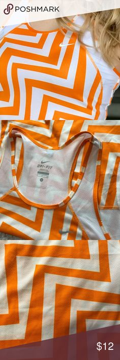 Nike DriFit Tank Top Gently used Nike DriFit tank top looking for a new home! Cute orange and white chevron-like design 🧡🧡🧡 Nike Tops Tank Tops