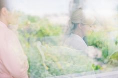Beautiful portrait of a bride behind glass... there is something so special about shooting with film.