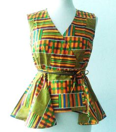 Kente peplum Ankara wrap top African clothing African Fashion African Top African Fabric African Blouse Ankara Blouse Ankara Fashion Sosome wrap style This is a easy wrap around top which you can adjust to fit your own body shape and size and looks great paired with Trousers. Size 12 Ankara Blouse, Ankara Tops, Ankara Styles, African Blouses, African Tops, African Prints, African Fabric, African Attire, African Dress