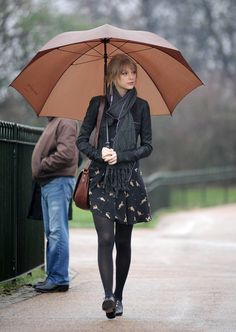 Taylor Swift Print Dress - Under her sleek leather jacket, Taylor wore a cat print dress and opaque tights.