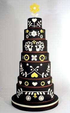 flawless black cake! I think it would be weird to eat black fondant though...