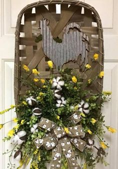 I love this tobacco basket with a corrugated galvanized tin rooster, cotton bolls, a cotton bolls bribbon bow, springtime greenery and yellow florals, dont you? This farmhouse flair door hanger can be ordered with a rooster as shown or with a chicken or pig. This would be ideal on