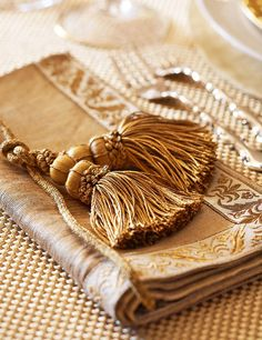 Gold tassels are a holiday classic for a formal dinner - Traditional Home®