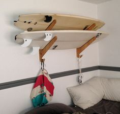 The Kaua'i Series Bamboo Surfboard Rack by Grassracks. For the avid surfer who loves to show off their boards. #surf #surfboard https://www.grassracks.com/collections/racks-surf-snow-and-wake/products/surfboard-rack