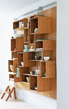Loving these wood shelves with different sizes and depths - makes for a great wall display with plenty of storage!