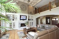 Traditional Family Room rock fireplace built in cabinets Design Ideas, Pictures, Remodel and Decor