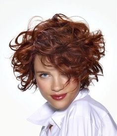 A medium brown curly coloured messy hairstyle by Saint Algue