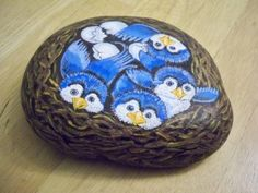 Painted rock birds nest