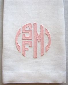 white linen guest towel with soft pink cotton sateen applique.