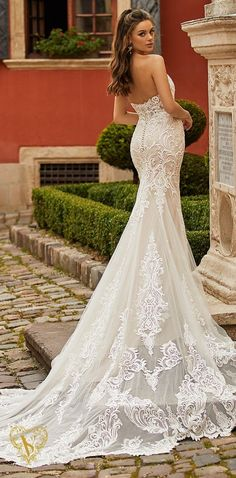 Glamorous mermaid wedding dress with strapless neckline, illusion back and long cathedral train | Val Stefani Spring 2021 Wedding Dress - Vienna/D8264 - Belle The Magazine #weddingdress #weddingdresses #bridalgown #bridal #bridalgowns #weddinggown #bridetobe #weddings #bride #dreamdress #bridalcollection #bridaldress #dress See more gorgeous bridal gowns by clicking on the photo