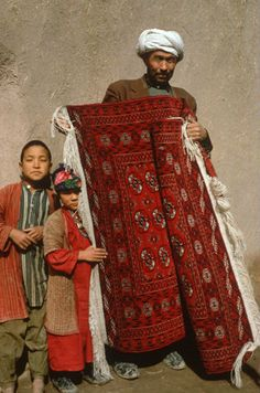 Afghanistan, Herat, Turcoman with carpet woven by wives