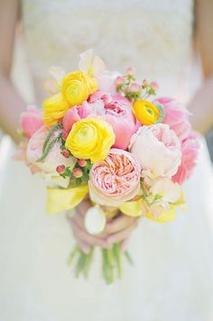 Wedding Bouquet Inspiration: This stunning spring color bouquet features bright yellow  ranunculus, pink peonies and garden roses. http://www.colincowieweddings.com/flowers-and-decor/flowers/bridal-bouquets
