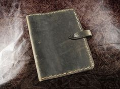 Hey, I found this really awesome Etsy listing at http://www.etsy.com/listing/82358832/leather-journal-cover-rugged
