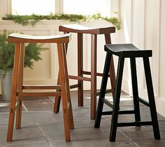 Tibetan Barstool #potterybarn we have 3 of the honey wood stools at the high dining table. They push underneath easily to hide away when not in use.